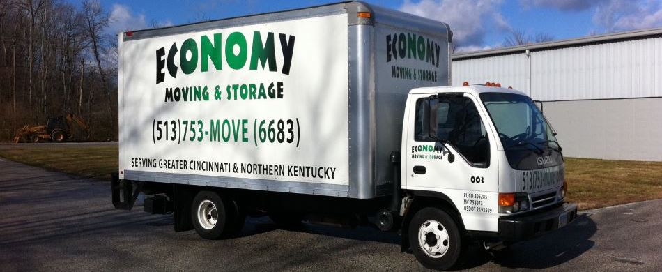 Economy Moving & Storage truck by warehouse