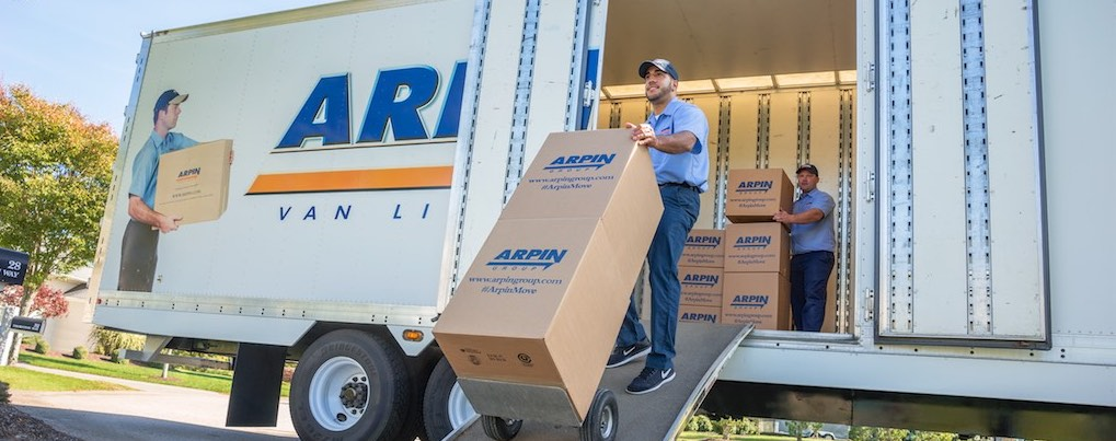 Arpin crewmen moving boxes off an Arpin truck