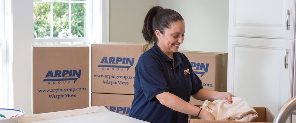 Arpin rep wrapping an item to pack