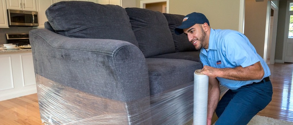 Man wrapping a couch