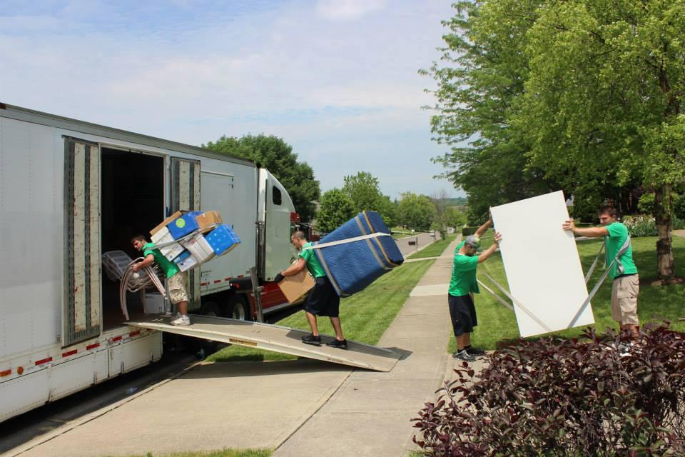 4 men loading a truck